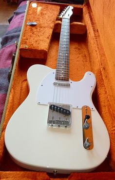 I would totally buy it if i could play it!    Olympic white Telecaster in zesty case