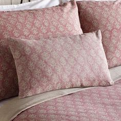 """THISTLE ROSE BOLSTER PILLOW--Hand printing, one by one with hand carved wood blocks, gives our homespun cotton bedding one-of-a-kind appeal. Soft shades of natural and rose are feminine, without being frilly. Zippered bolster pillow cover with feather/down insert. Machine washable. Imported. Exclusive. 12""""W x 20""""L."""