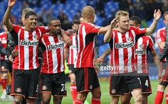 Sunderland players celebrate at the end of the game during the Barclays Premier League match between Everton and Sunderland at Goodison Park on May 09, 2015 in Liverpool, England.