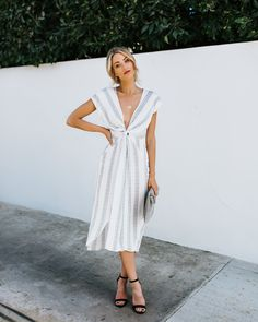 e4a3a79a406a White   gray length-ways stripes on this summer dress.