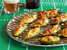 Sunny Anderson's Smoked Gouda-Chorizo Jalapeno Poppers - Filling hollowed pepper halves with cheese, chorizo, cream cheese and more, then baking them until bubbly. http://www.foodnetwork.com/recipes/sunny-anderson/smoked-gouda-chorizo-jalapeno-poppers-recipe.html