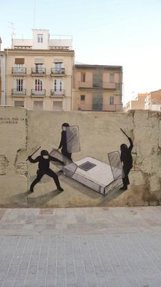 The painting is a part of a series of murals painted in Valencia, Spain, by a group of artists and performers from Escif. #BannedBookWeek