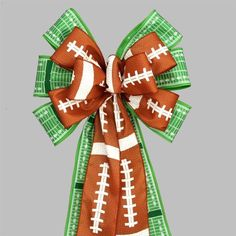 "Football Pigskin Field Yardline Party Bow - perfect for decorating for a birthday party or tailgating event.  Bow Size: 10"" width x 19"""