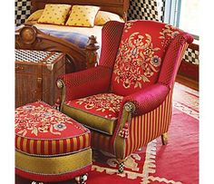 red chair and ottoman - I don't think I'd like to have this particular chair, but I kinda like the idea of the different fabrics.