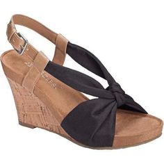 Sassy wedge sandal with knot detailing and an adjustable strap for a secure fit.