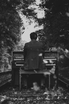 - Black & White. Piano. Falling leaves (?). Railway track. Oh, this must be art.