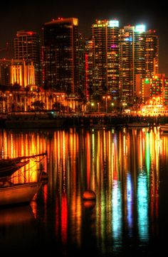 A portion of the San Diego skyline reflecting on the bay. By Paul Koester.
