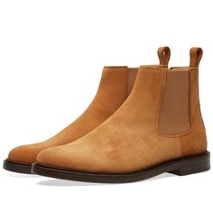 The Ethan Boot from Parisian masters A.P.C. have been crafted from a soft suede and are styled with the details that make a Chelsea boot so iconic. Elasticated panels to either side ensure a comfortable fit whilst a stacked leather sole lends the boot a classic finish.  Suede Upper Elasticated Side Panels Leather Footbed