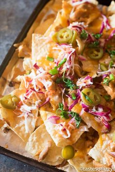 Firecracker Chicken Nachos pack a flavor punch with spicy buffalo sauce and sweet chili sauce. Slow cook the chicken a day in advance for quick, 15 minute meal on those busy evenings. Yummy Chicken Recipes, Mexican Food Recipes, Beef Recipes, Nacho Recipes, Turkey Recipes, Casserole Recipes, Best Party Appetizers, Appetizer Recipes