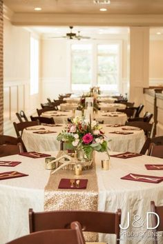 Gorgeous maroon and gold wedding table decor. Set up at Magnolia Manor, a large southern mansion in Houston, TX.