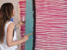 Kelly Wearstler painting her fabrics.