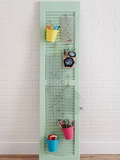 Nothing to Shutter About      Deck out a window shutter with S hooks and buckets to hold office and craft supplies. The stacked horizontal slats allow you to adjust the hooks and arrange all of your items to the perfect reaching height.