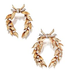 PAIR OF 14 KARAT GOLD, PLATINUM AND DIAMOND WREATH BROOCHES, VERDURA, CIRCA 1940    Each depicting a pair of laurel boughs tied with a diamond ribbon with small round diamonds scattered thoughout the leaves, the total diamond weight 1.30 carats, gross weight 19 dwts., signed Verdura.