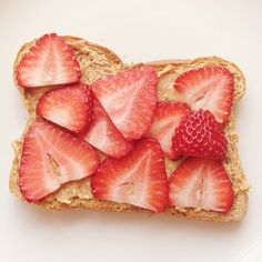 wheat bread, crunchy peanut butter, and strawberry slices