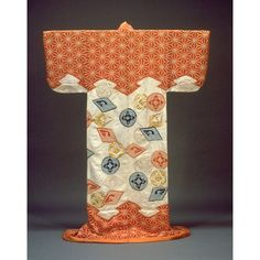 Edo Period 18th c. Kosode (Short-Sleeved Kimono) with Pine Bark Lozenges, Hemp Leaf Design, and Scattered Crests in Tie-dyeing and Embroidery on Parti-colored, Figured-Satin Ground.  Kyoto National Museum