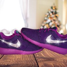 Nike Purple Running Shoes Swarovski Crystals Brand New in Box Authentic Women's Nike Roshe Run Shoes in Purple! Outer Nike Swoosh is customized with gorgeous Swarovski Crystal Rhinestones! Nike Model # 511882-450 Crystals- 100% Authentic Swarovski Crystals (Made in Austria) Condition: Nike's are Brand New in Box and 100% Authentic, purchased from an authorized Nike retailer. Customized in a smoke-free environment. Free of any odors or stains. Crystals are set in place with industrial…