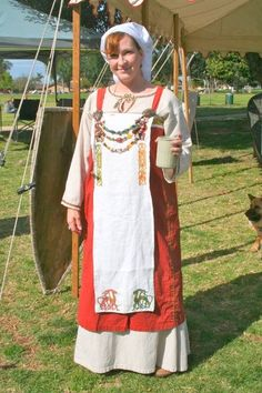 Viking garb. Handmade and hand embroidered. I also made the festoons.