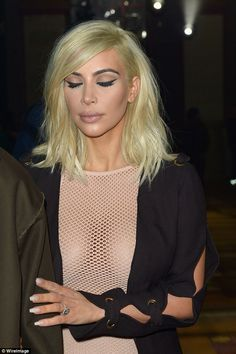 Love all Kim K's looks.  Kim K can rock just about any style.  Her platinum hair resembles Debbie Harry. Perfectly winged eyeliner is perfection.