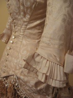 2012-08-25 KSMF -  Silk damask and silk faille wedding dress trimmed with satin ribbon and fringe, owned by Harriet Snyder King, May 1879.