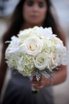 White Bridesmaids Bouquet with roses, hydrangea and dusty Miller by @fasanibel Photo Credit to: @Impressions Photography Beach Wedding @South Seas Island Resort Designed & Planned by Kelly McWilliams Celebrations, Weddings & Parties
