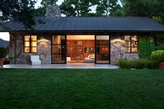 """Architect Gregg De Meza designed this custom guest house to be a natural extension of its """"older brother"""" next door while paying extra attention to the use of space and materials. The end result is a 640-square-foot modern living, sleeping and lounge space that fits in seamlessly into its surroundings. From the experts at HGTV.com."""