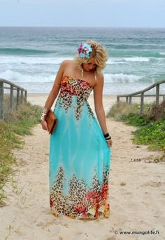 I want to be on a beach, wearing this dress, and sporting this tan!
