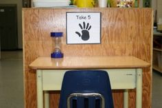 This area is set up to be totally student centered. They walk over the to the desk, sit down, and turn over the timer. When the timer is up, they quietly rejoin the group. This routine is explicitly taught and there are consistent expectations. This allows the teacher to continue on with the lesson.