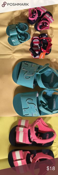 Baby girls Gymboree sandal bundle 3-4sz Baby girl Gymboree sandal bundle size 3-4. Pink and navy with big bows, turquoise with elephants and red white and blue! Great mix of colors and perfect for summer and spring weather. Material is water proof and rubbery never worn Gymboree Shoes Sandals & Flip Flops