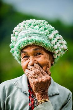 French photographer Réhahn came up with an idea to explore the feeling of joy and the act of smiling on the faces of Vietnamese people. 'Hidden Smiles in Vietnam' is his latest photo series where people cover their smiles with their palms, but still leave evidence of the bright emotion in their vivid eyes and faces.