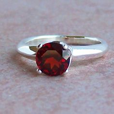 Garnet Ring- Red Garnet represents love, passion, devotion, brings courage and hope. This is a stone of commitment.