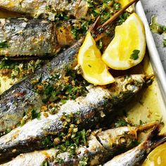 Beautifully grilled sardines with a medley lemon, rosemary, parsley, garlic, green olives and capers. A stunning fish recipe from Rick Stein's Fish & Shellfish.
