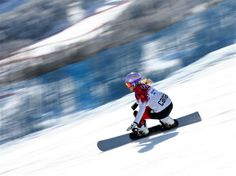 Ariane Lavigne of Canada competes in the Snowboard Ladies' Parallel Giant Slalom Quarterfinals. Sochi 2014 Day 13 - Snowboard Ladies' Parallel Giant Slalom. © 2014 XXII Winter Olympic Games.