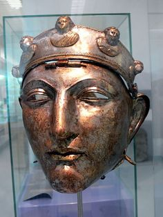 """The Nijmegen Helmet is an Ancient Roman helmet, found in a gravel bed on the left bank of Waal river, near the Dutch city of Nijmegen in 1915. The helmet would have been worn by the elite Roman cavalry.[1] The head portion of the helmet is made of iron, while the mask and diadem are of bronze or brass. The helmet has a neck-protecting projecting rim, overlaid with a thin bronze covering plated with silver.[2] The diadem features two male and three female figures."""
