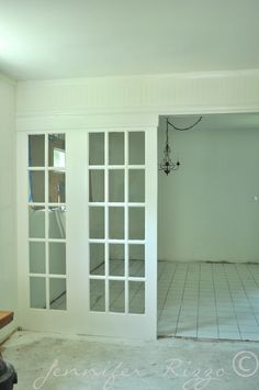 Vintage french doors used as a room divider
