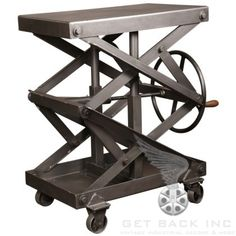 ORIGINAL VINTAGE INDUSTRIAL ADJUSTABLE STEEL SCISSOR LIFT TABLE  Industrial Adjustable Scissor Lift Table. Height is adjustable from 25 1/4″ to 44 1/4″. Top measures 32″ x 20″. Overall dimensions are 38″ x 23 1/2″ (including wheel handle).