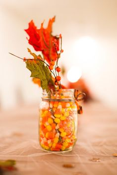 Candy Corn and Fall Leaf Centerpieces | Photo: Eden Bliss Weddings |
