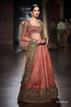 Ruby silk lehenga- choli featuring a Jamawar shawl print and fine zardozi-tilla dori embroidery paired with a delicate gold tulle dupatta