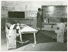 Interior of school on Mileston Plantation; School begins very late in the year and attendance is poor until December because the children pick cotton, Mileston, Mississippi Delta, Mississippi, 1939.