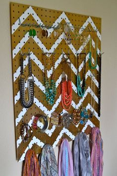 I like the idea of a peg board for organization but always found them so fugly.  Here's an idea for making it look nicer.