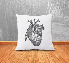 A simple anatomical heart throw pillow. | 27 Infectiously Cool Gifts For Medical Nerds