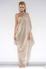 Karl Lagerfield designed this for Chanel it reflects back to the toga's worn by roman men.