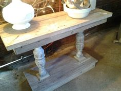 Console table made from barn wood and salvaged table legs.