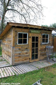 Pallet Shed Using Pallets, Old Windows & Tin Cans pallet garden shed potting old windows cans, diy, 1001 Pallets, Recycled Pallets, Wooden Pallets, Recycled Wood, Recycled Cans, Shed From Pallets, Chicken Coop From Pallets, Pallet Chicken Coops, Wooden Boxes