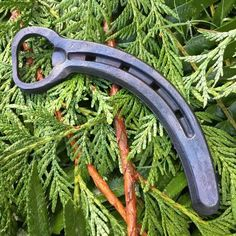 """Upcycled horseshoe hand forged into a bottle opener. Great Groomsman gift for your wedding party or for your favorite horse person. Measures 5.5"""" x 2.5"""" Each has been fired in the forge, wire brushed, and clear coated giving them a dark iron look. They are sold separately and are one of a kind and will be chosen at random. Our current turnaround time is 1-2 weeks. If you need it sooner we do have a """"rush my order"""" listing that can put your order on the top of the pile and…"""