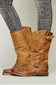 FREEBIRD by Steven Prescott Mid Boot at Free People Distressed leather boot with bronze hardware detailing. Adjustable gusset strap with buckle closure. The perfect leather boot for the fall!By FREEBIRD by Steven