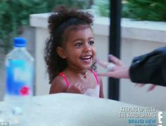 Cute curls: North's curly hair was proving difficult for Kim to style