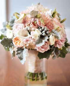 Bouquet of café au lait dahlias, Juliet roses, silver brunia, dusty miller, mini calla lilies, ranunculuses, and blush roses