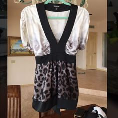 Bebe animal print  blouse. Beautiful, sexy and silky animal print blouse. Like new condition. bebe Tops Blouses