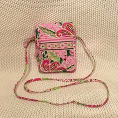 SALE!  Vera Bradley Mini Hipster Crossbody Bag Fun pink and green Mini Hipster offers organization in a compact silhouette. The velcro on the front flap makes for easy access to the interior pockets and ID window. Super cute and perfect for Spring or Summer. Great Condition. Vera Bradley Bags Crossbody Bags