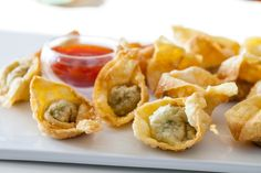 Chinese Fried Wontons Recipe.  I've been searching for a recipe like some my mom made, but my only clues are that she used hamburger and green onion.  (these have green onions)  Maybe I'll finally find the recipe :)